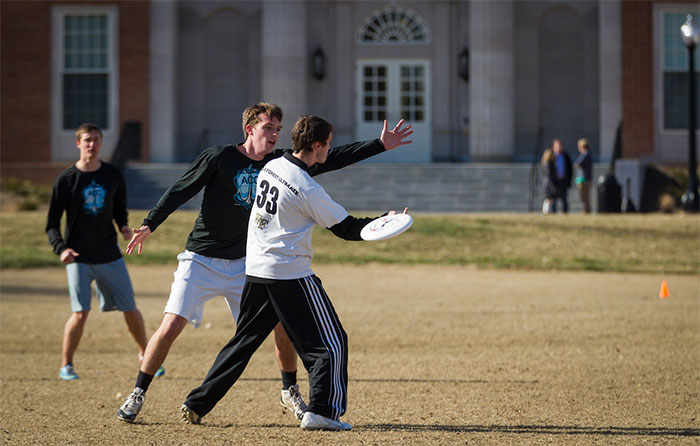 The Wake Forest ultimate frisbee team practices on Poteat Field