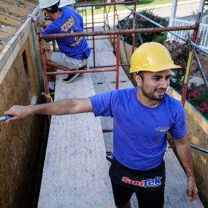 Photo of Students working at a Habitat for Humanity site