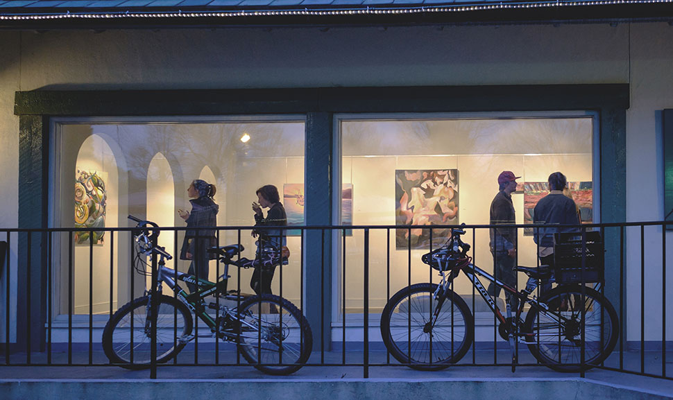 Wake Forest students attend the opening of a show of paintings at the START gallery in Reynolda Village on Tuesday, January 20, 2015.