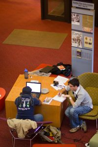Wake Forest students work in the lobby of the Scales Fine Arts Center.