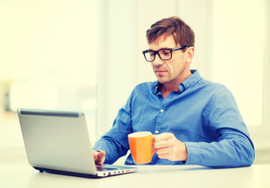 stock-photo-man-working-with-laptop-at-h-1200265