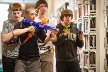 Students prowl the stacks during Humans vs. Zombies in the library.