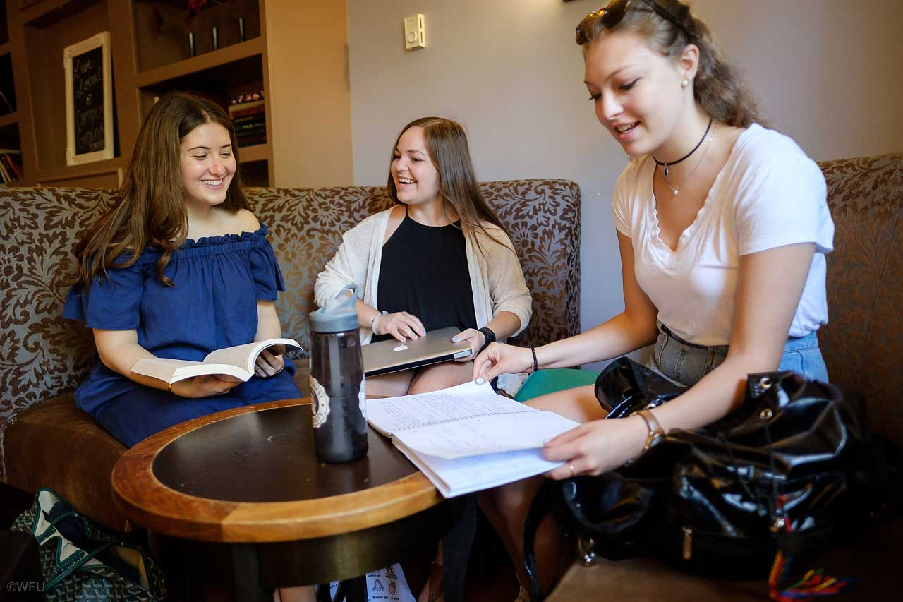 Wake Forest juniors Jamie Lichtenstein ('18), Robyn Adelkopf ('18) and sophomore Zoe Kreutzer ('19) hang out together in the campus coffee shop