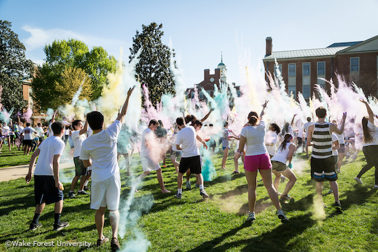 Wake Forest students celebrate Holi, the Hindu spring festival of colors, by throwing packets of colored powder on each other on Manchester Plaza on Saturday, April 11, 2015.