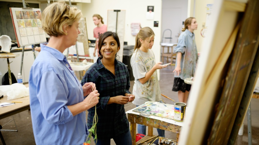 Art professor Page Laughlins with Diane Eapen ('15) in studio art class
