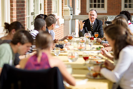 President Hatch enjoying lunch with students on the patio of the Magnolia Room.