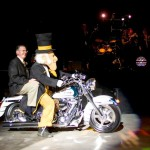 President Hatch enters the inaugural President's Ball with the Demon Deacon.