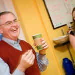 President Hatch visits the Campus Grounds coffee shop on campus to try a new drink named after him, made by student manager Stephanie Strader.