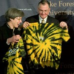 Dr. and Mrs. Hatch are presented with Demon Deacon tie-dyed t-shirts