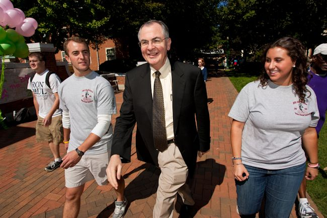 President Hatch walks a lap with student organizers at Hit the Bricks.