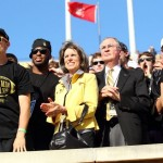 President Hatch and his wife, Julie, watch a football game with students.