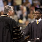 President Hatch shakes hands with Jermyn Davis ('10) at Commencement.
