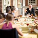 President Hatch enjoys lunch with students on the patio of the Magnolia Room