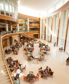 Business students enjoy the atrium in the new Farrell Hall, home of the Wake Forest Schools of Business.