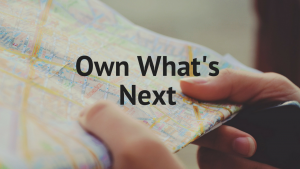 Own What's Next, photo of person's hands holding a map