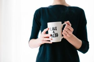 "Woman holding a mug that says ""Like a Boss"""