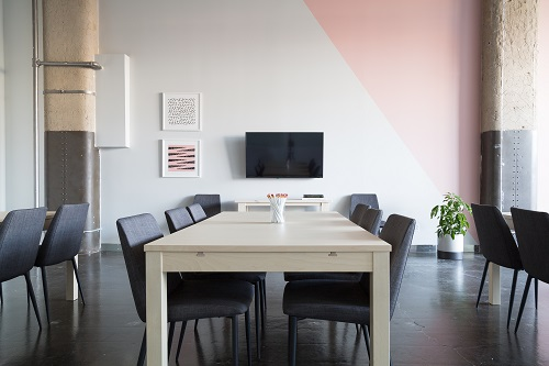 Chairs around a table in a meeting room