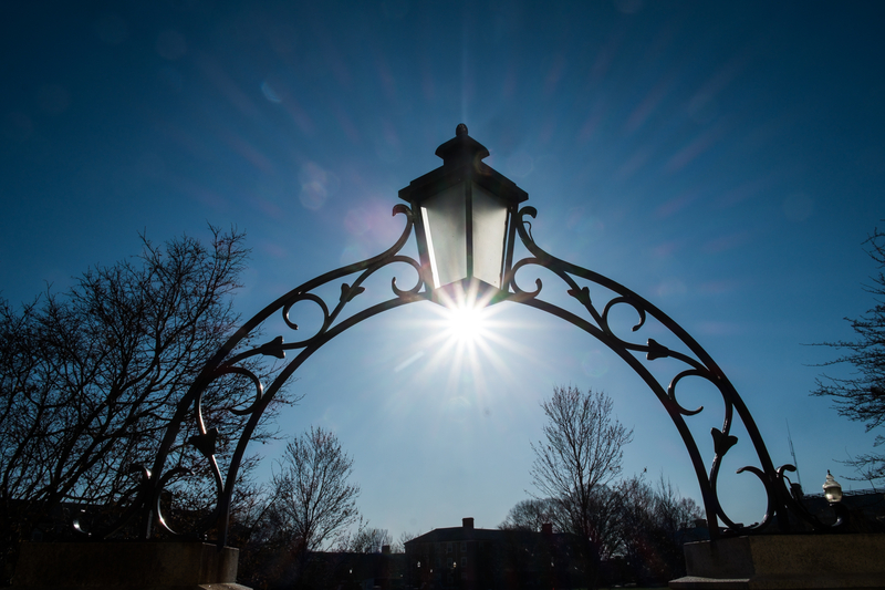 Morning Sun Peeks Through Arch of Efird Residence Hall, Hearn Plaza