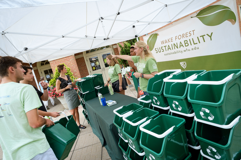 Sustainability Booth on Move-In Day, Recycling Containers