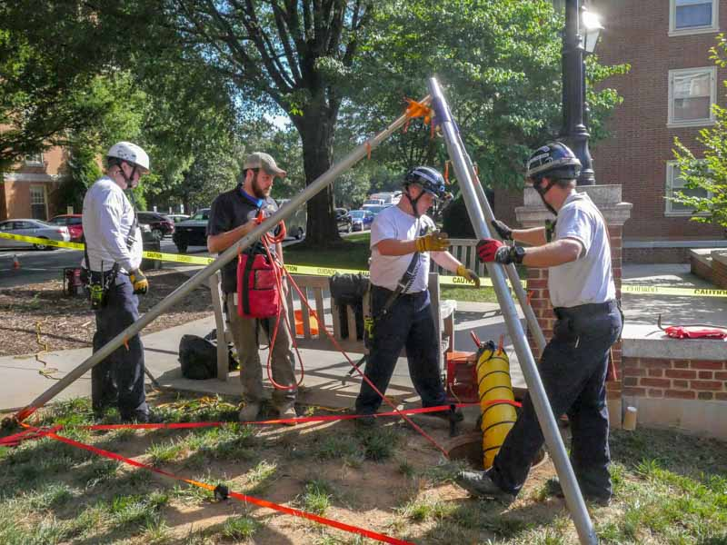 rescue team sets up ropes for confined spaces training