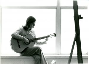 Patricia Dixon with a guitar.