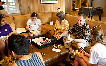 President Hatch and his wife, Julie, eat with students.