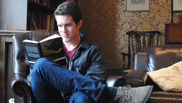 Junior Drew Thies reads in Wake Forest's Worrell House in London.