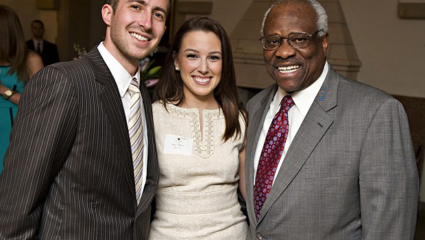 Marc Rigsby ('13) and Shay Miller ('13) pose with U.S. Supreme Court Justice Clarence Thomas.