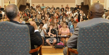 Students at the IB World Conference participate in a Q&A with Darryl Hunt and Mark Rabil. (Photo courtesy of the Winston-Salem Journal.)