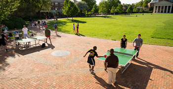 Students play ping-pong on the Quad.