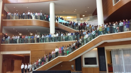 All 140 MA students fill the stairs in Farrell Hall.