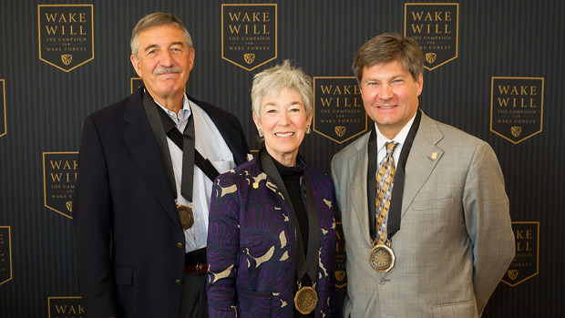 Mike (l) and Debbie (c) Rubin and Bobby Burchfield (r) attend a luncheon in their honor.