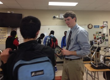 Daniels talks with a student after the meeting.