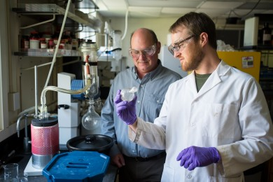 Wake Forest chemistry graduate student Thomas Poole and professor Bruce King talk about their research in a lab in Salem Hall