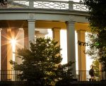 Wake Forest students enjoy a beautiful late summer morning as they walk across campus to class.