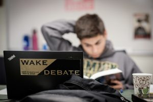 Wake Forest debaters work with head coach and debate director Jarrod Atchison in the team room in Carswell Hall on Wednesday, May 6, 2015.