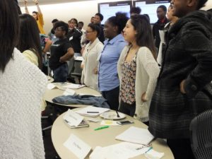 Students stand together during a College LAUNCH session.