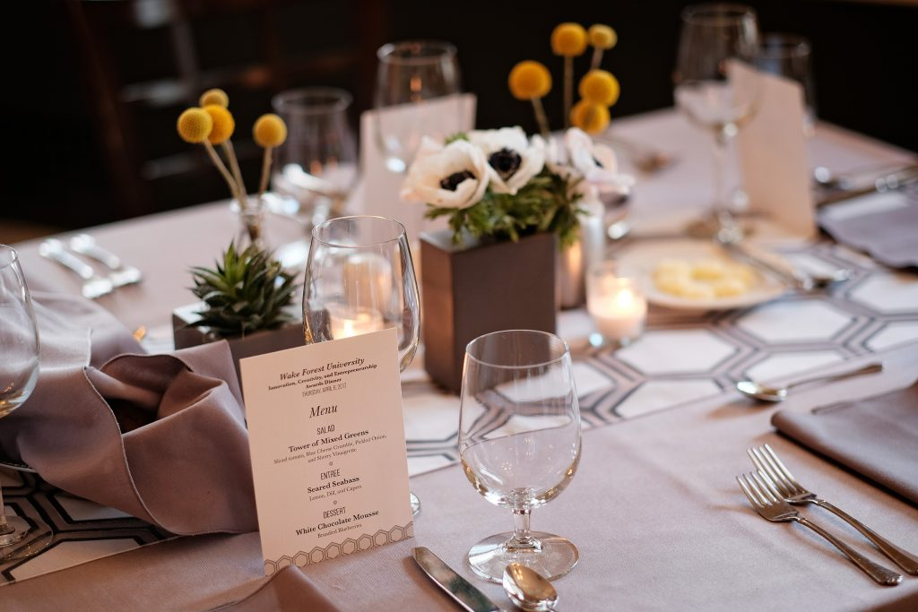 Table setting with billy ball flowers, anemones, and glassware