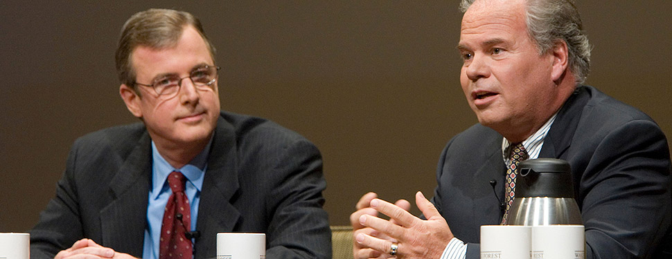 John Medica, right, talks with business leader Eric Wiseman ('77, MBA '88, P '07) at a Wake Forest conference.