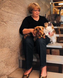Janet Cage with her pets in the basement where they rode out the tornado.