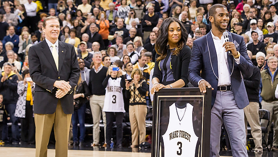 Chris and Jada Paul at the jersey ceremony with Ron Wellman, director of athletics