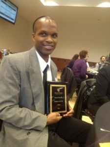 Travis Manning ('93) with his Employee of the Year award.