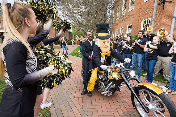 Members of the Wake Forest community gather on Hearn Plaza to welcome new men's head basketball coach Danny Manning, during the Mann the Quad event on Tuesday, April 8, 2014. Manning makes his grand entrance on the Demon Deacon's motorcycle.
