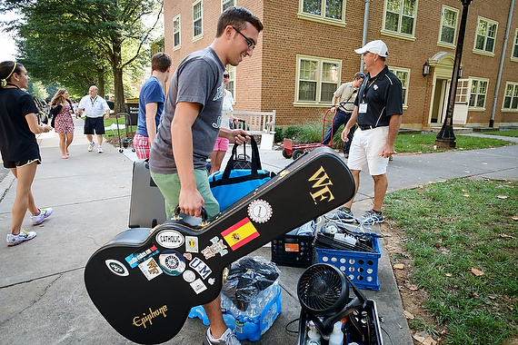 Wake Forest freshmen and their families arrive for move-in day on campus on Thursday, August 21, 2014. Nick DeMayo ('18), moves his guitar into his room in Babcock Residence.