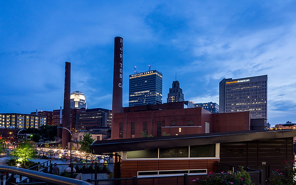 The skyline of Winston-Salem as seen from Bailey Park in the Wake Forest Innovation Quarter at dusk on Thursday, June 18, 2015.