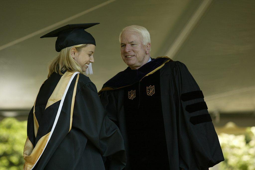 Senator John McCain greets a graduate.