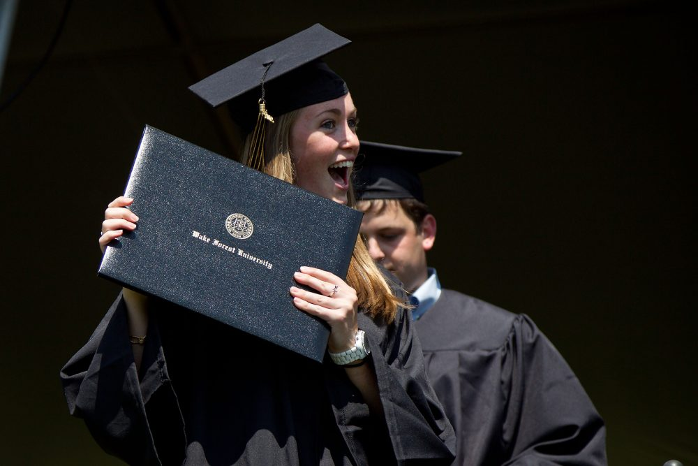Students cross the stage to receive their diplomas.