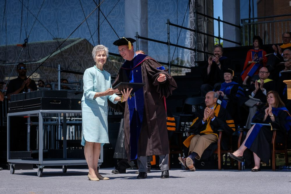 President Nathan O. Hatch presents a posthumous diploma for business school student Neal Chastain to his mother, June Booth.
