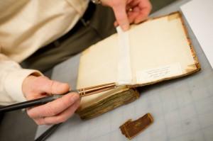 Craig Fansler repairing a book