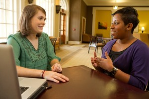 Senior Rebecca Hinson, at left, interviews academic advisor Tiffany Waddell for her Wake at Work oral history project.